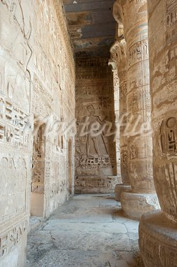 Egyptian hieroglyphic carvings on a wall at the temple of Medinat Habu in Luxor with columns Stock Photo - Royalty-Free, Artist: paulvinten                    , Code: 400-05739654
