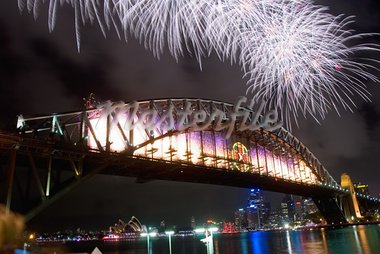 Sparkling New Year Eve nye Fireworks in Sydney Harbour Sky Line At Night, NSW, Australia, Oceania. The Sydney harbour bridge and sydney opera house sparkling in the night. Colourful surface. Night scene Stock Photo - Royalty-Free, Artist: mroz                          , Code: 400-05740623
