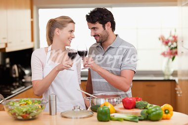 Lovely couple drinking a glass of wine in their kitchen Stock Photo - Royalty-Free, Artist: 4774344sean                   , Code: 400-05741861