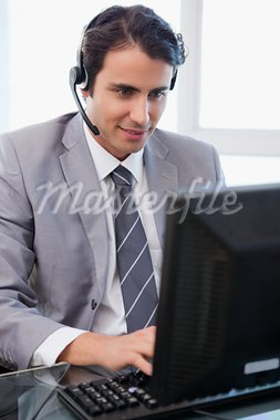 Portrait of a happy sales assistant working with a monitor in his office Stock Photo - Royalty-Free, Artist: 4774344sean                   , Code: 400-05741959