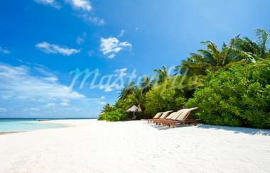 Beautiful tropical paradise in Maldives with palms hanging over the white and turquoise sea Stock Photo - Royalty-Free, Artist: Fyletto                       , Code: 400-05742449