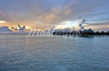 Beautiful vivid sunset over water villas in the Indian ocean, Maldives Stock Photo - Royalty-Free, Artist: Fyletto                       , Code: 400-05742451