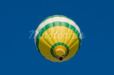 Green, white and yellow hot-air balloon airborne, shot from beneath Stock Photo - Royalty-Free, Artist: balefire9                     , Code: 400-05742479