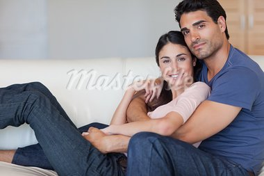 Lovely young couple posing in their living room Stock Photo - Royalty-Free, Artist: 4774344sean                   , Code: 400-05742617
