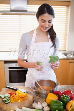 Portrait of a woman cooking a soup in her kitchen Stock Photo - Royalty-Free, Artist: 4774344sean                   , Code: 400-05742643