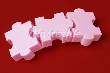 Three interlocking jigsaw puzzle blocks on red background Stock Photo - Royalty-Free, Artist: Design56                      , Code: 400-05742662