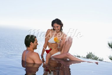 Happy couple having a cocktail in a swimming pool Stock Photo - Royalty-Free, Artist: 4774344sean                   , Code: 400-05742822