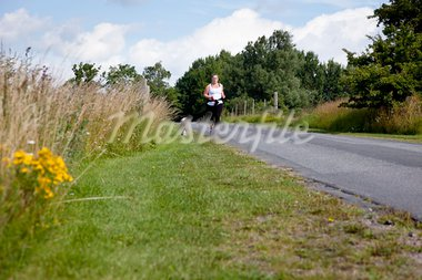 Sporty woman and dog jogging along a road in summertime Stock Photo - Royalty-Free, Artist: Multiart                      , Code: 400-05742866