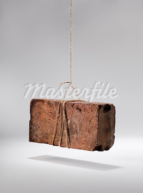 Old worn and weathered brick hanging by a piece of string. Stock Photo - Royalty-Free, Artist: stocksnapper                  , Code: 400-05742986