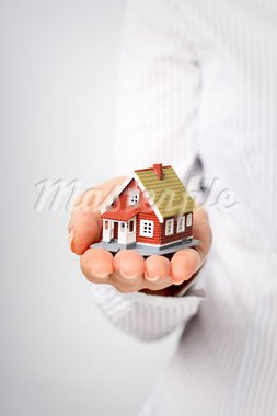 Real estate concept. Small house in hand. Stock Photo - Royalty-Free, Artist: fantazista                    , Code: 400-05743295