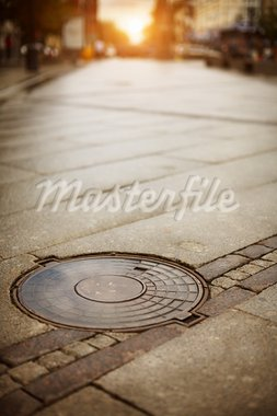 Manhole cover, selective focus Stock Photo - Royalty-Free, Artist: Kuzma                         , Code: 400-05743958