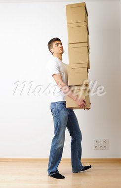 Young man carrying a stack of boxes Stock Photo - Royalty-Free, Artist: haveseen                      , Code: 400-05744588