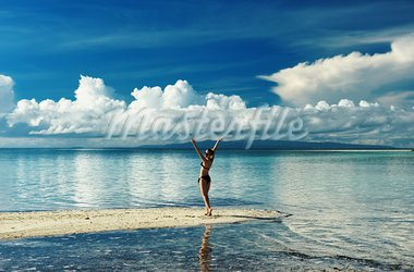 Girl on a tropical beach with outstretched arms Stock Photo - Royalty-Free, Artist: haveseen                      , Code: 400-05744736