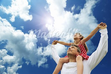 Father and daughter against sky Stock Photo - Royalty-Free, Artist: haveseen                      , Code: 400-05744808