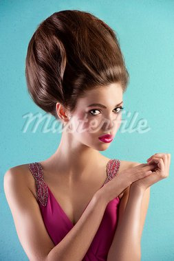 fashion shot of a beautiful brunette with a couture hair style wearing a pink evening dress Stock Photo - Royalty-Free, Artist: carlodapino                   , Code: 400-05745322
