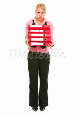 Tired female business secretary holding folders stack   Stock Photo - Royalty-Free, Artist: citalliance                   , Code: 400-05745902