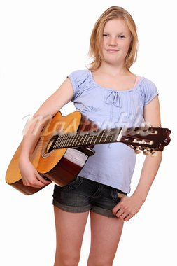 Portrait of a teenage girl holding a classical guitar Stock Photo - Royalty-Free, Artist: pahham                        , Code: 400-05745954