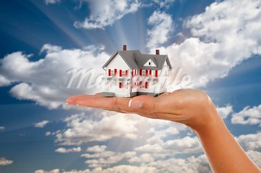 Model House in Female Hand on a Cloud and Sky Background. Stock Photo - Royalty-Free, Artist: Feverpitched                  , Code: 400-05746327