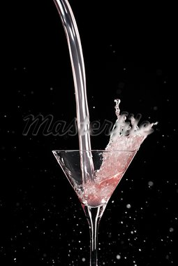 Overwhelming pour in a Martini glass on black Stock Photo - Royalty-Free, Artist: gorgev                        , Code: 400-05747566