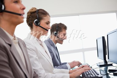 Side view of customer service department at work Stock Photo - Royalty-Free, Artist: 4774344sean                   , Code: 400-05748314
