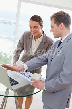 Market analyst talking with customer about research results Stock Photo - Royalty-Free, Artist: 4774344sean                   , Code: 400-05748368