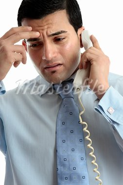 Stressed, depressed, worried or upset business man using telephone.  Useful for many situations.  White background. Stock Photo - Royalty-Free, Artist: lovleah                       , Code: 400-05748648