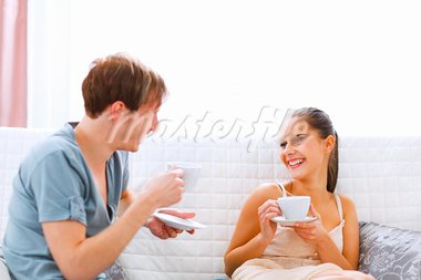 Young couple sitting at couch and drinking coffee   Stock Photo - Royalty-Free, Artist: citalliance                   , Code: 400-05749207