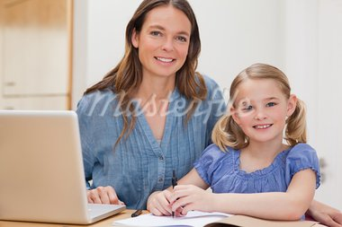 Beautiful woman helping her daughter doing her homework in a kitchen Stock Photo - Royalty-Free, Artist: 4774344sean                   , Code: 400-05749561