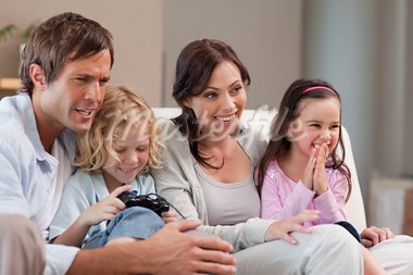 Happy family playing video games together in a living room Stock Photo - Royalty-Free, Artist: 4774344sean                   , Code: 400-05749661