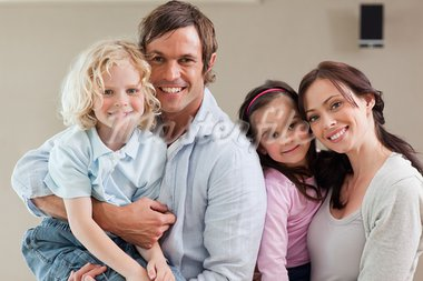 Lovely family posing together while looking at the camera Stock Photo - Royalty-Free, Artist: 4774344sean                   , Code: 400-05749707
