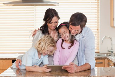 Family using a tablet computer together in a kitchen Stock Photo - Royalty-Free, Artist: 4774344sean                   , Code: 400-05749715