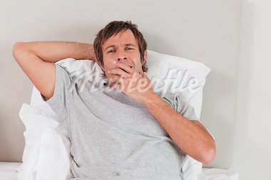 Tired man yawning in his bedroom Stock Photo - Royalty-Free, Artist: 4774344sean                   , Code: 400-05749776