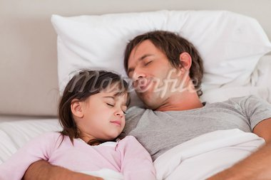 Father sleeping with his daughter in a bedroom Stock Photo - Royalty-Free, Artist: 4774344sean                   , Code: 400-05749811