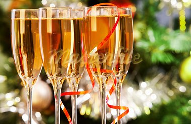 Several champagne flutes on Christmas background Stock Photo - Royalty-Free, Artist: pressmaster                   , Code: 400-05749963