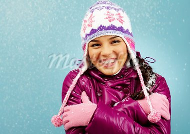 Smiling girl looking at camera showing how cold she is Stock Photo - Royalty-Free, Artist: pressmaster                   , Code: 400-05749973