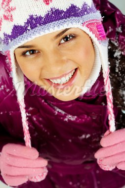 Pretty woman in winter clothes looking at camera with smile Stock Photo - Royalty-Free, Artist: pressmaster                   , Code: 400-05749975