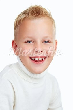 Portrait of cute boy smiling while looking at camera Stock Photo - Royalty-Free, Artist: pressmaster                   , Code: 400-05750943