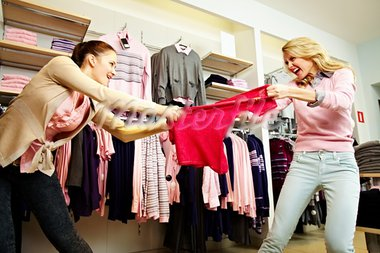 Image of two greedy girls fighting for red tanktop in department store Stock Photo - Royalty-Free, Artist: pressmaster                   , Code: 400-05750983