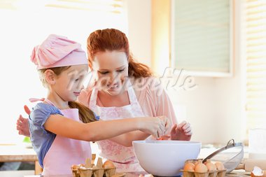 Mother and daughter preparing cookies together Stock Photo - Royalty-Free, Artist: 4774344sean                   , Code: 400-05751223