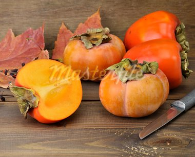 Persimmon Fruits On Wooden Background ,Close Up Stock Photo - Royalty-Free, Artist: svetlanna                     , Code: 400-05751373