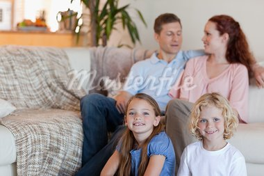 Family enjoying their time together in the living room Stock Photo - Royalty-Free, Artist: 4774344sean                   , Code: 400-05751505