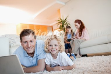 Father and son using the internet together in the living room Stock Photo - Royalty-Free, Artist: 4774344sean                   , Code: 400-05751523
