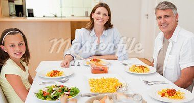 Happy family sitting at dinner table together Stock Photo - Royalty-Free, Artist: 4774344sean                   , Code: 400-05751811