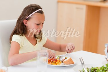 Girl having dinner at the dinner table Stock Photo - Royalty-Free, Artist: 4774344sean                   , Code: 400-05751823