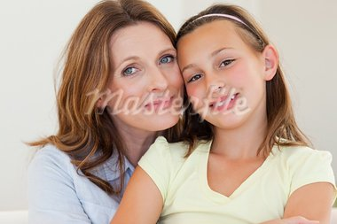 Smiling mother hugging her daughter Stock Photo - Royalty-Free, Artist: 4774344sean                   , Code: 400-05751872