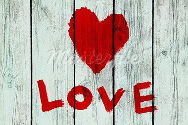 drawing love symbol and word ''love'' on old wooden wall Stock Photo - Royalty-Free, Artist: didesign                      , Code: 400-05754078