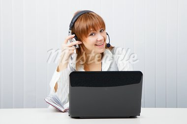 girl in headphones with a microphone and a laptop Stock Photo - Royalty-Free, Artist: pzRomashka                    , Code: 400-05754718