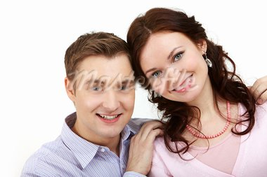 Young girlfriend and boyfriend looking at camera and smiling Stock Photo - Royalty-Free, Artist: pressmaster                   , Code: 400-05754932