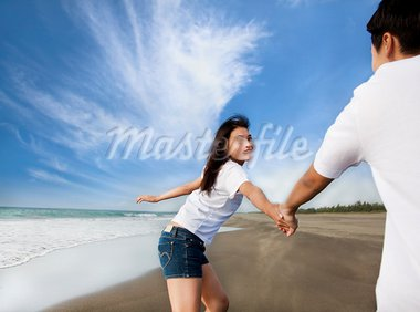 happy asian couple running on the beach Stock Photo - Royalty-Free, Artist: tomwang                       , Code: 400-05755191