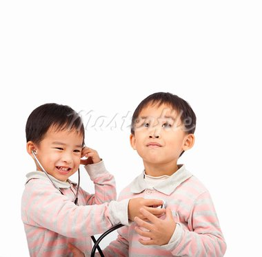 two kids with health examination by stethoscope Stock Photo - Royalty-Free, Artist: tomwang                       , Code: 400-05755410